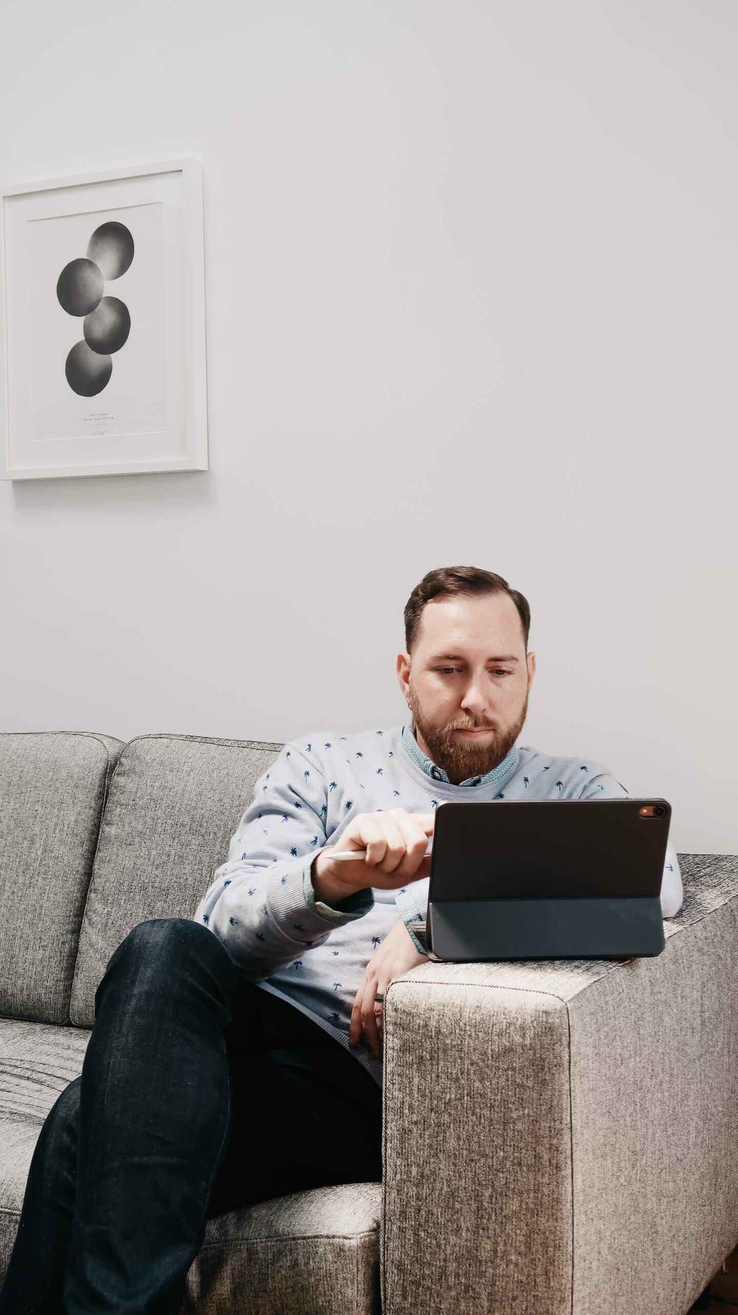 Man reading off of iPad.